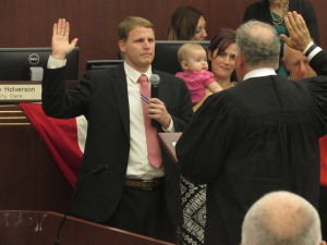 New Escondido Treasurer Douglas Shultz takes the oath surrounded by family during the swearing in ceremony on Wednesday. Photo by Steve Puterski