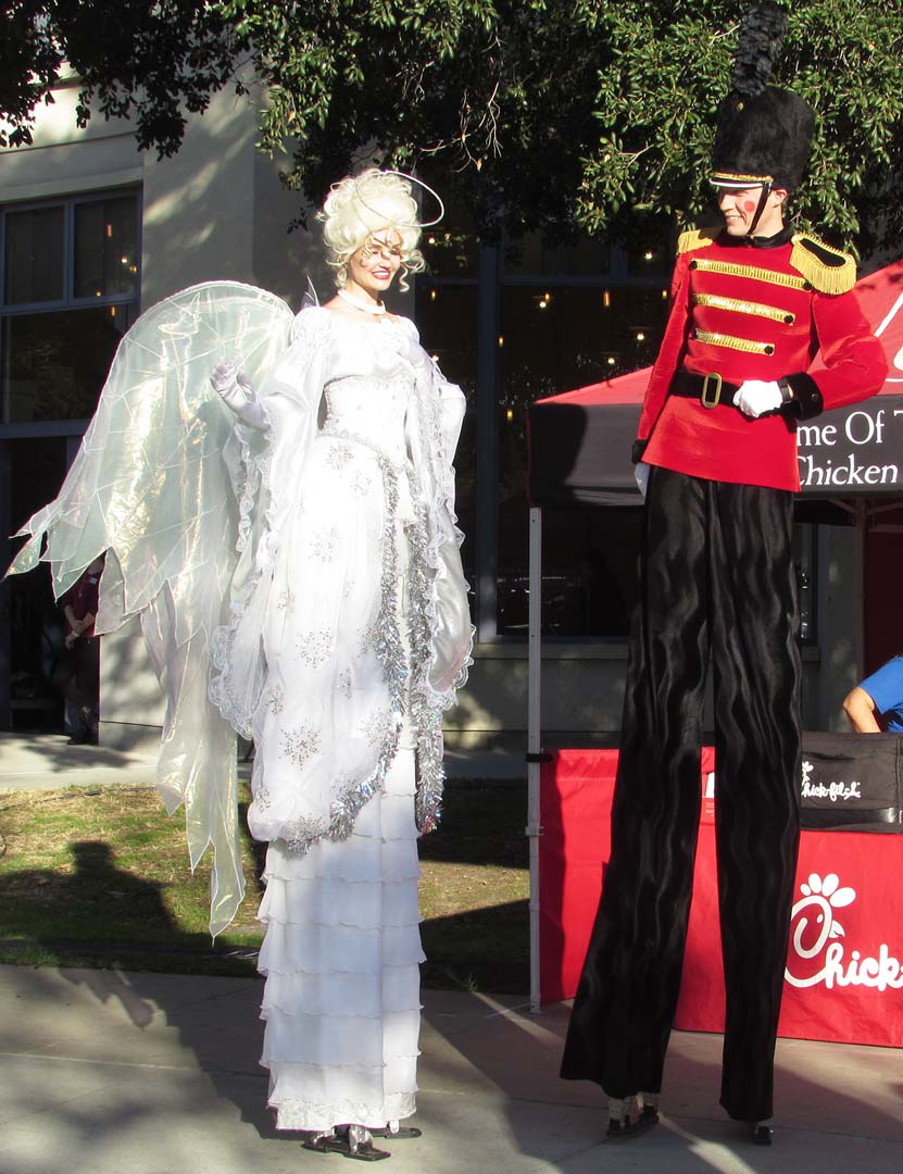 Two stilt walkers roam the grounds of the California Center for the Arts, Escondido. Photo by Steve Puterski