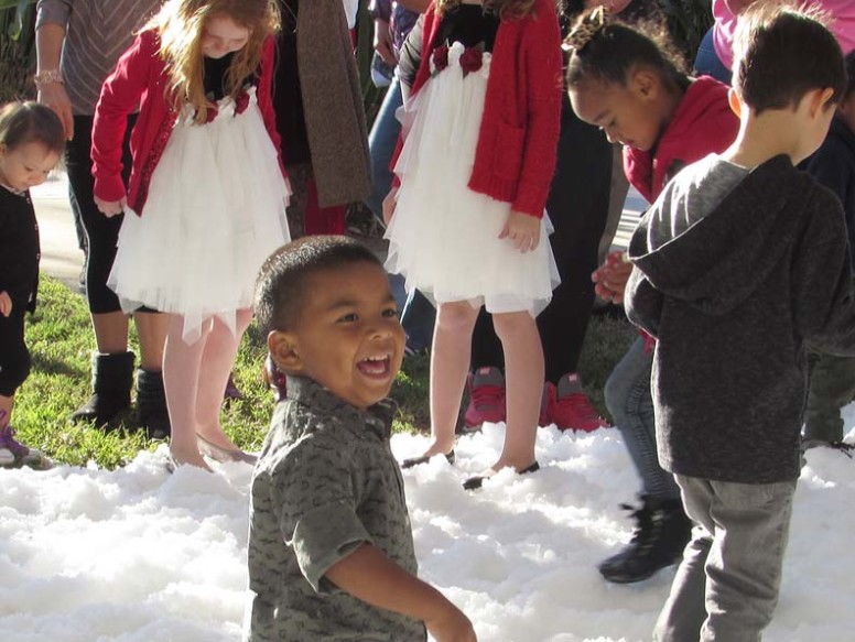Kids engage in snowball fights and some frolicking in the snow. Photo by Steve Puterski
