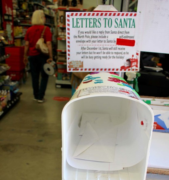 Store staff collects letters daily and forwards them to Santa helpers. Last year 800 letters were received company-wide. Photo by Promise Yee