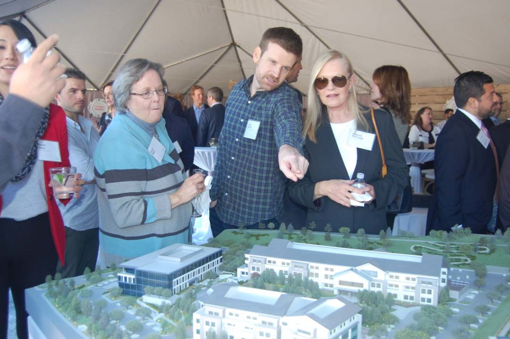 People attending the Jan. 25 groundbreaking for One Paseo check out a 3-D model of the mixed-use development. Photo by Bianca Kaplanek