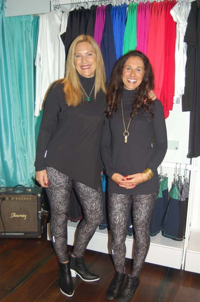 Kimberly Caccavo and Kate Nolan, founders of Graced by Grit, show off their new Chelsea leggings at a Dec. 7 launch party. A portion of all sales goes to the Chelsea's Light Foundation.  Photo by Bianca Kaplanek