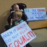 Alice Sodeman, 8-months-old, and brother Carson Sodeman get an early lesson in political movements. Photo by Tony Cagala