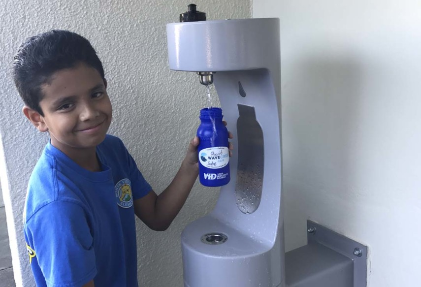 David Salas, a fifth grader at Vista's Monte Vista Elementary School, fills his new Love Tap! water bottle.  Courtesy photo