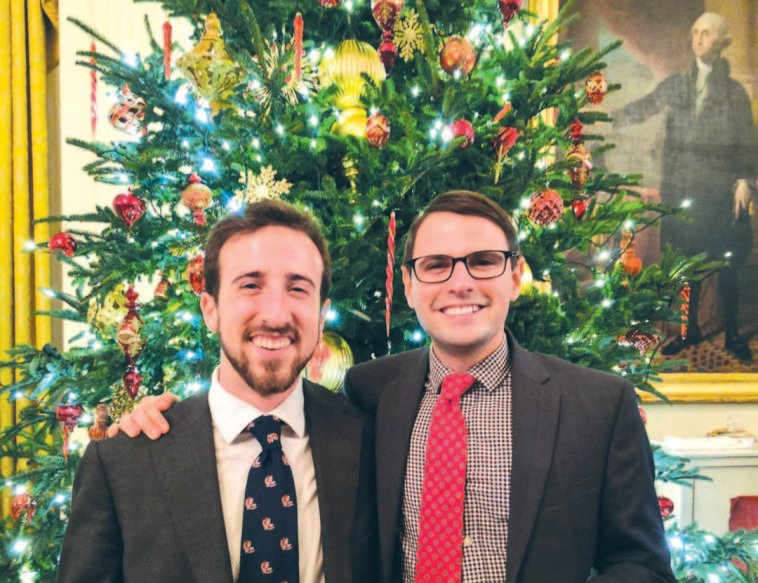 Jacob Sztraicher, left, and Max Oltersdorf attend a White House Christmas dinner. The Encinitas duo, graduates of San Dieguito High School Academy, served as staffers in President Barack Obama's administration over the last year.  Courtesy photo