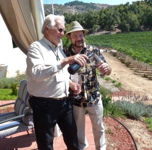 Altipiano Vineyard and winery co-Owner Peter Clarke, left, pours a Super Tuscan for columnist Frank Mangio. The wine was a recent gold medal winner. Photo courtesy Frank Mangio