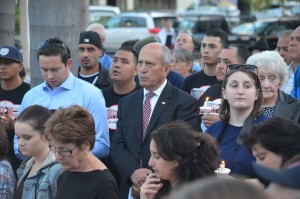 Escondido Mayor Sam Abed is one of the more than 100 people to attend a candlelight vigil for Catherine Kennedy. Photo by Tony Cagala