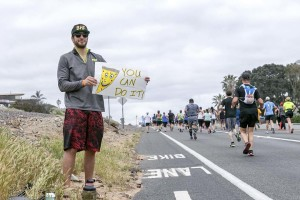Racers get support from well-wishers along the half-marathon route. Photo by Bill Reilly