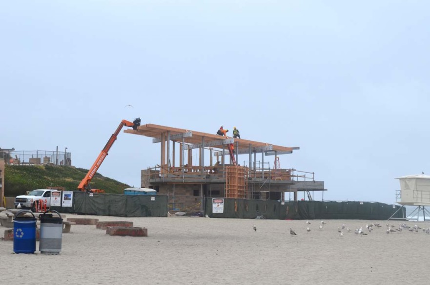 Construction crews continue to build the new marine safety center on Moonlight Beach. City officials said on Wednesday the grand opening of the new center will be delayed until possibly late summer. Photo by Tony Cagala