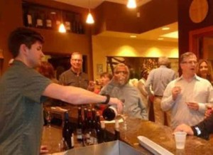 Nathan Sneller of Meritage Wine Market in Encinitas pours a select group of Pinot Noirs from California and Oregon at their popular Friday night tastings.