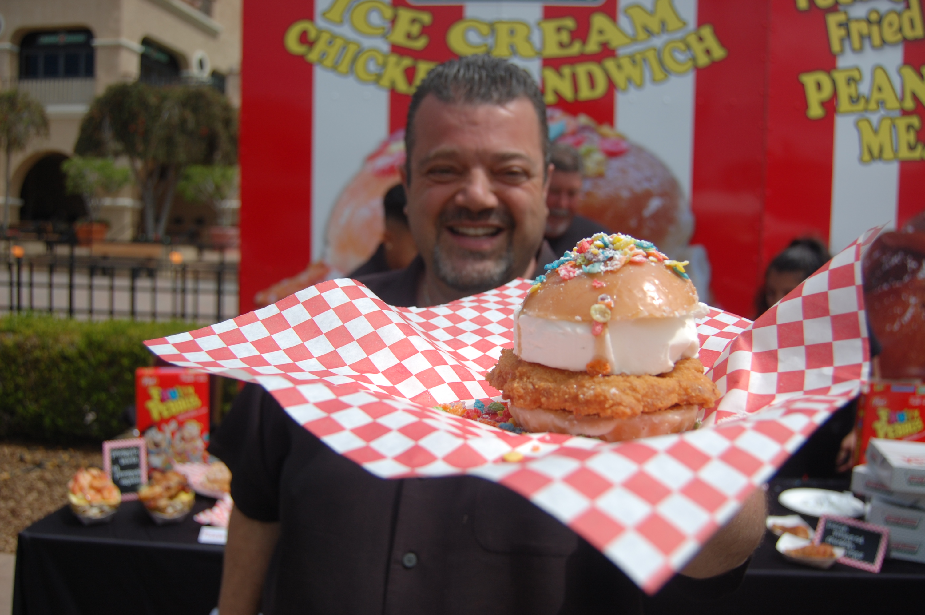 Charles Boghosian, better known as Chicken Charlie, shows off the Krispy Kreme chicken ice cream he created for the 2017 San Diego County Fair. It's a fried boneless chicken breast and 5-ounce slab of Blue Bunny vanilla ice cream between two jelly doughnut halves topped with Fruity Pebbles.