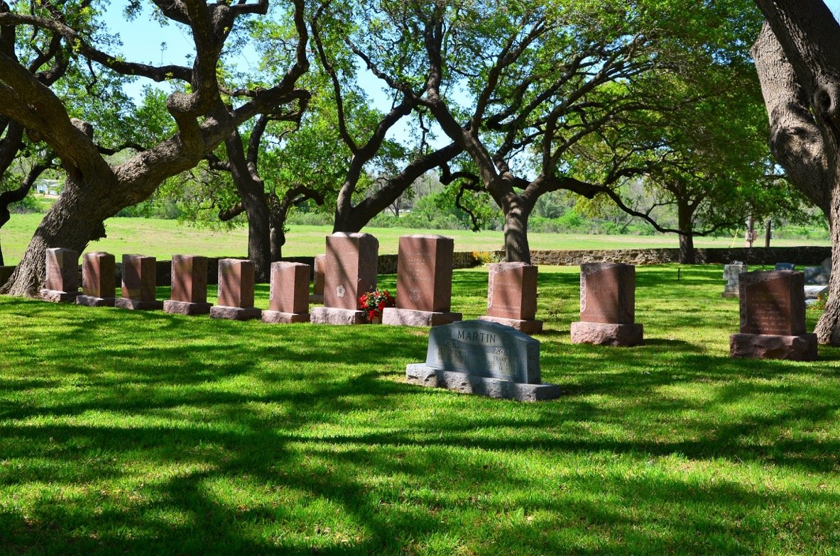 """Johnson Family Cemetery """"I come down here almost every evening when I'm at home,"""" President Lyndon Johnson said of the family cemetery located on the property of his beloved ranch near Stonewall, Texas, 63 miles west of Austin. """"It's always quiet and peaceful here under the shade of these beautiful oak trees."""" Johnson and wife, Lady Bird, are buried here. Photo by Jerry Ondash"""