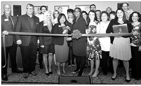 Team members at Silverado Encinitas Memory Care join with Encinitas Chamber of Commerce and dignitaries at the celebration of the Community remodeling on April 11. Courtesy photo