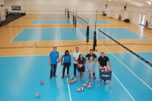 Showing off the four new indoor courts, which feature a state-of-the-art shock-absorbent flooring used in the Olympics, are former Olympic volleyball players Steve Timmons and Beverly Buffini, Doug and Lindsey Forsyth, Matt Olson and Brennan and Kristen Dean. Photo by Bianca Kaplanek