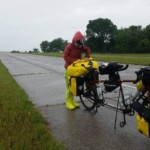 On May 30, near Joplin, Mo., Jenny adjusts some of the 70 pounds of gear she and Dan are hauling on their tandem bike. This was their first 100-mile day and they rode through three states: Oklahoma, Kansas and Missouri.