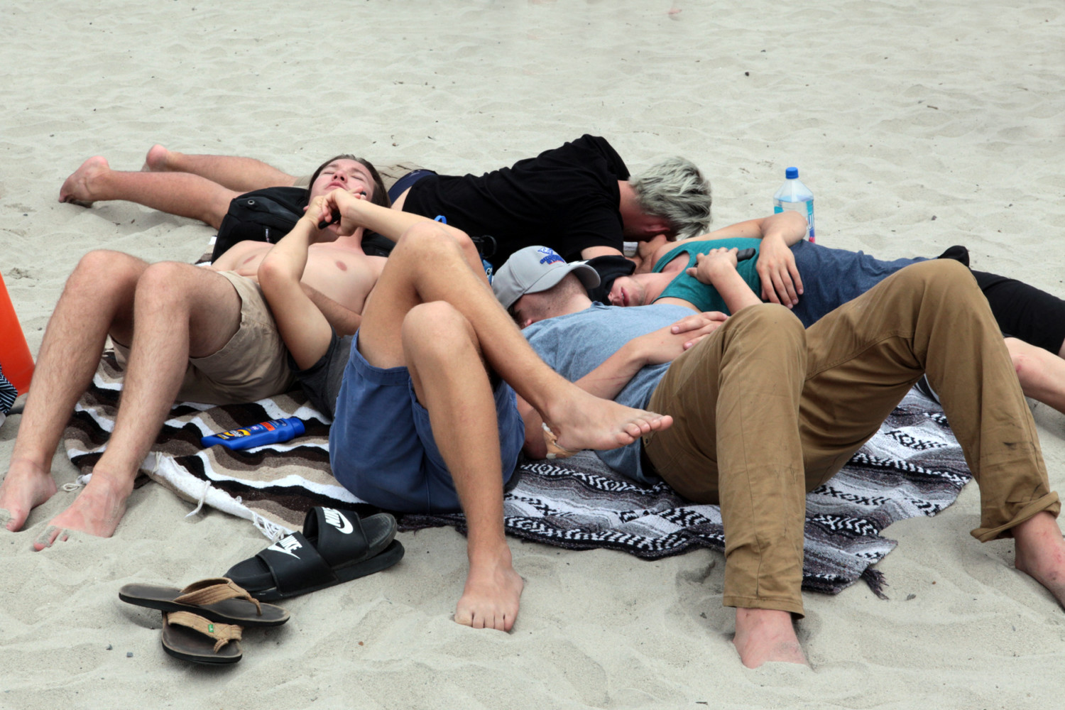 Beachgoers grab some shuteye on the beach before Switchfoot took the stage. Photo by Pat Cubel