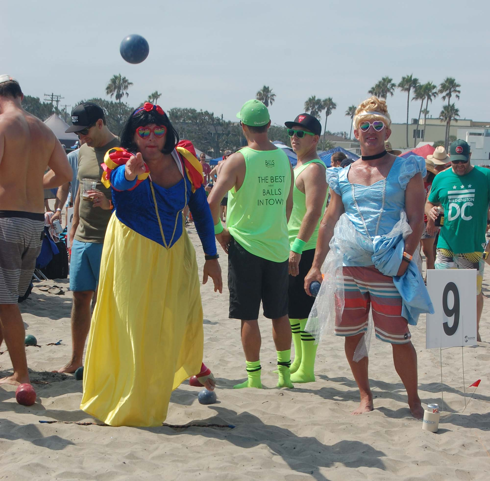 Bocce players have a ball on the beach