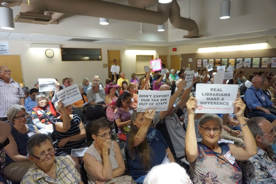 Community coalition fights to keep library public
