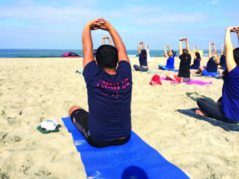 Applegate does yoga with supporters at Moonlight Beach