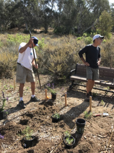 Board members of the Batiquitos Lagoon Foundation help install plants in a new butterfly bee garden located behind the lagoon's Nature Center in Carlsbad. Photo courtesy of Liz Paegel