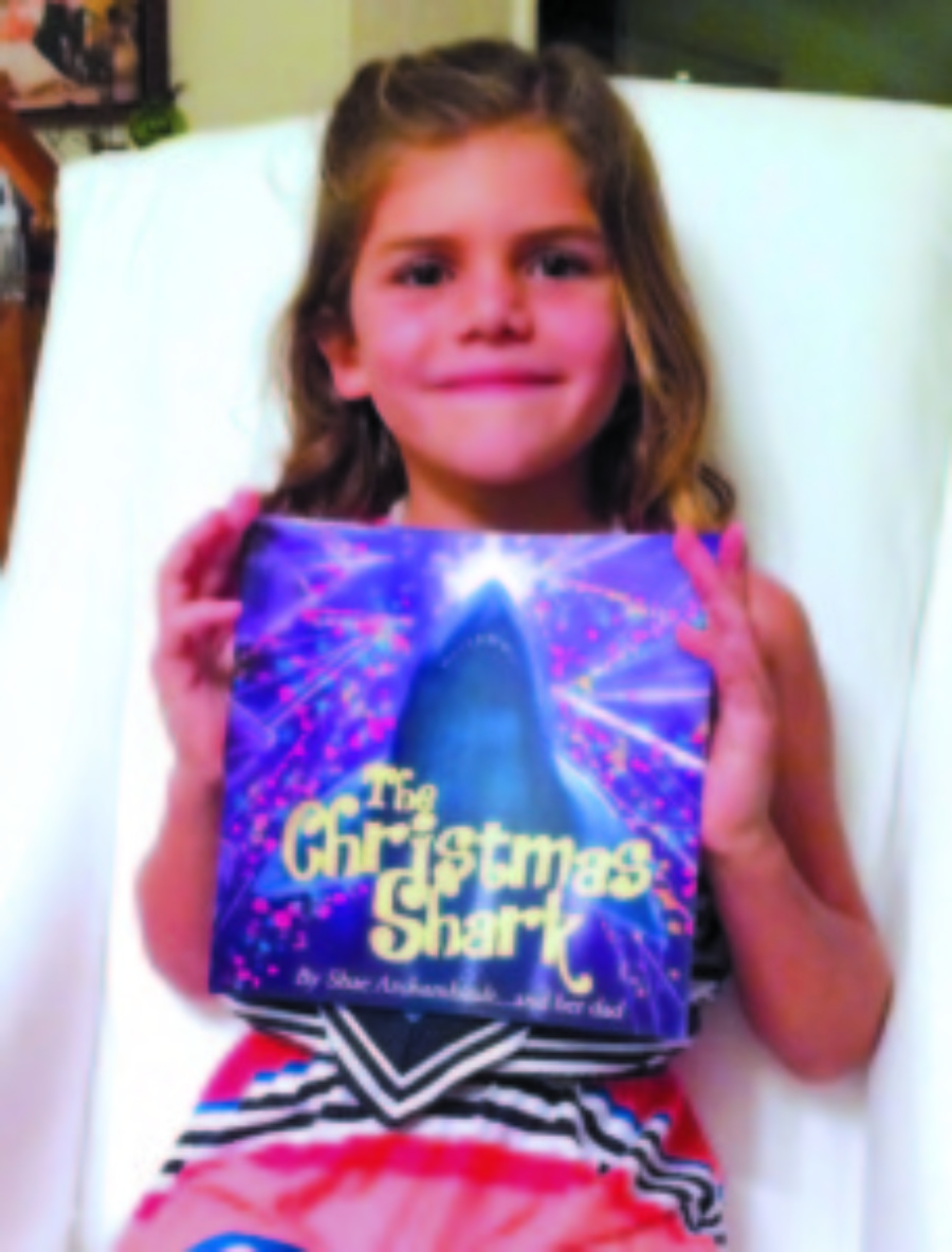Girl, father pen shark-themed holiday book