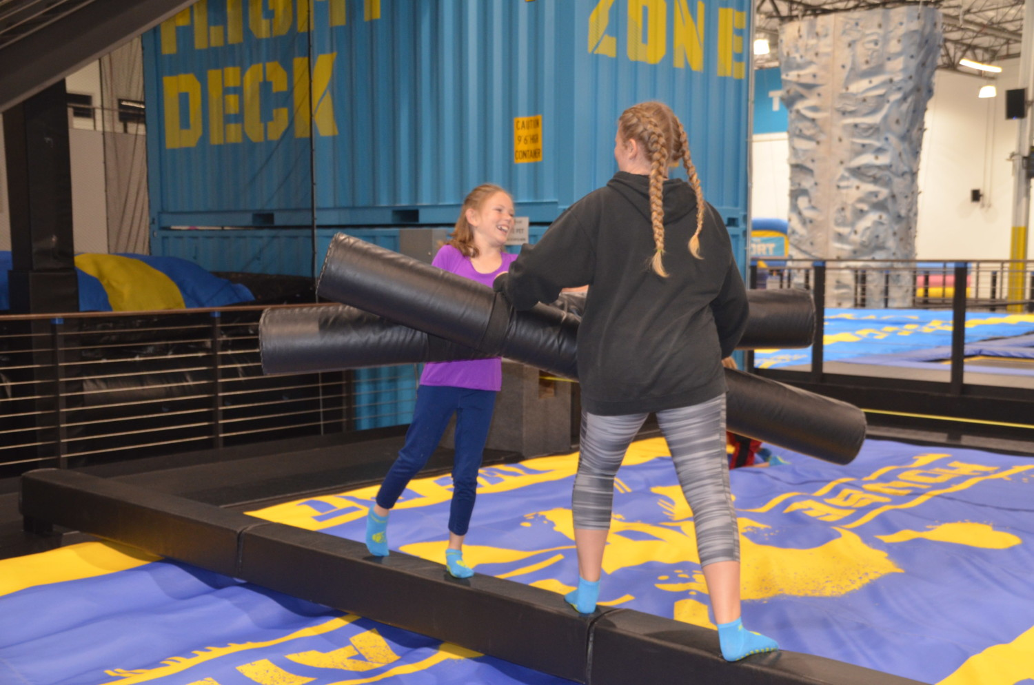 Visitors can participate in mock combat with padded pugil sticks that send players into air bags on both sides of the platform. Photo by E'Louise Ondash