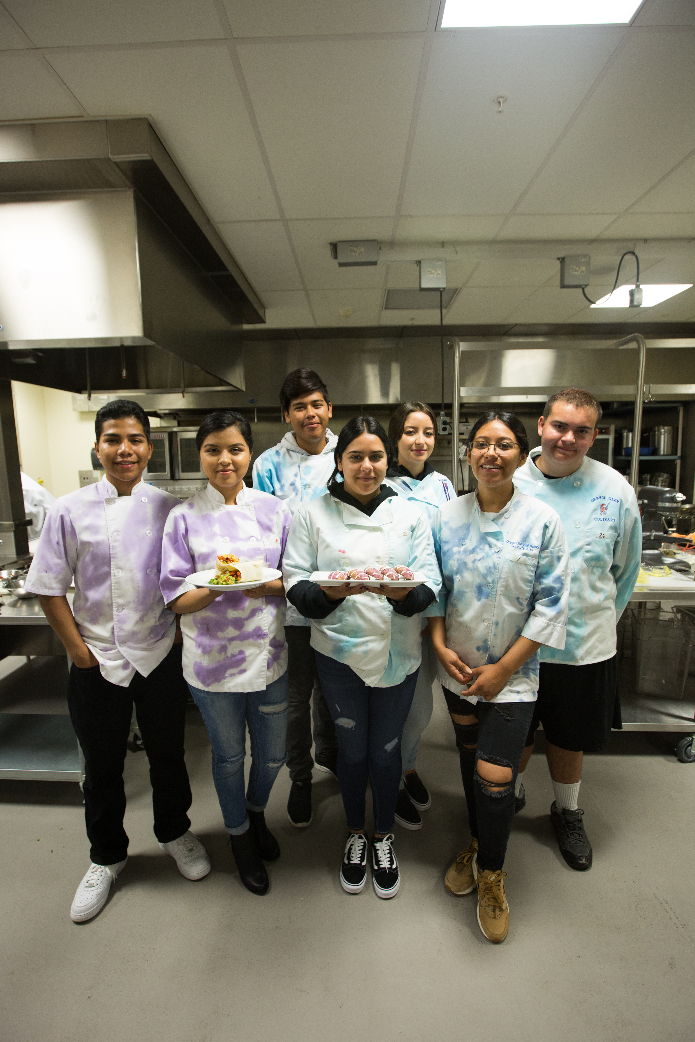 Orange Glen High School students make dishes for local restaurants and Uber eats for a class project Tuesday in Escondido. Pictured left to right: Ivan Soria, Monica Luna, Jose Fabian, Celia Delatorre, Joanna Payan, Alma Anguiano, Alec Ellsworth.