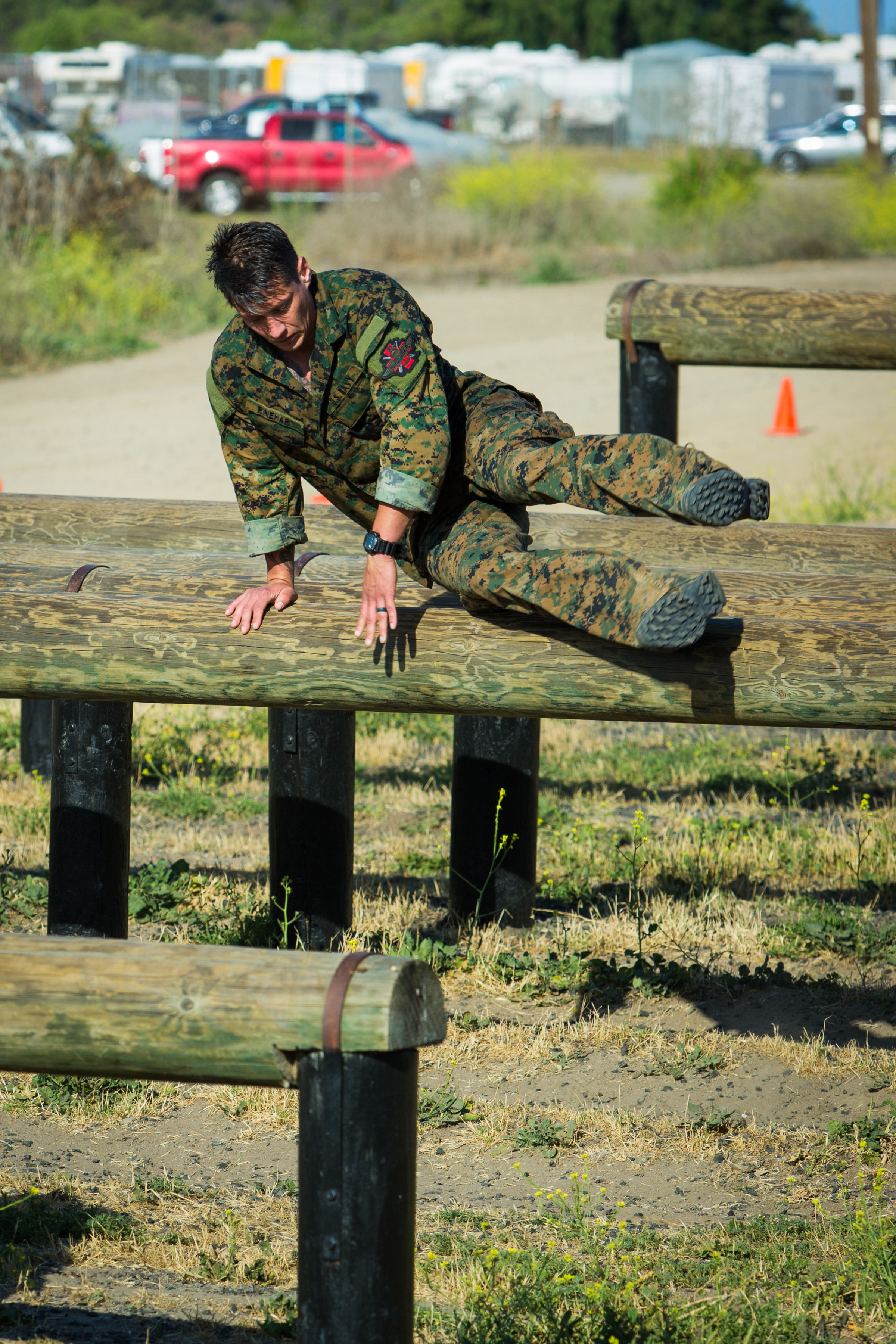 Chief Hospital Corpsman Dave Rinehardt tackles the obstacle course of the Recon Challenge in memory of his fallen brother Ryan Lohrey Thursday morning at Camp Pendleton.