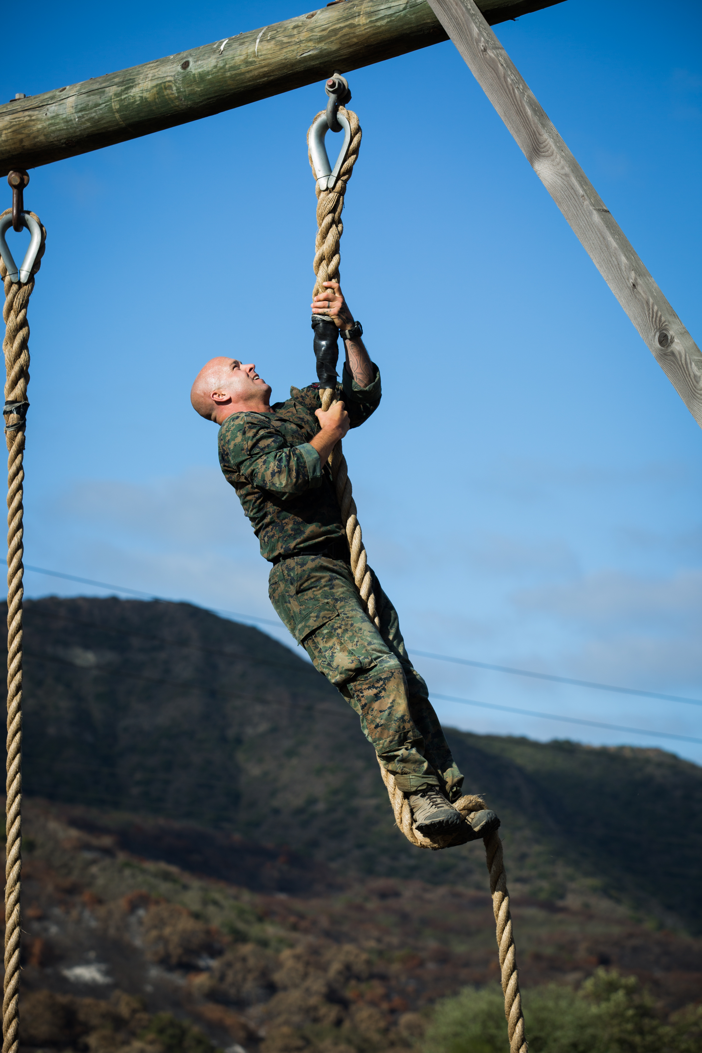 Chief Hospital Corpsman John E. Bohan III tackles the obstacle course of the Recon Challenge in memory of his fallen brother Ryan Lohrey Thursday morning at Camp Pendleton.