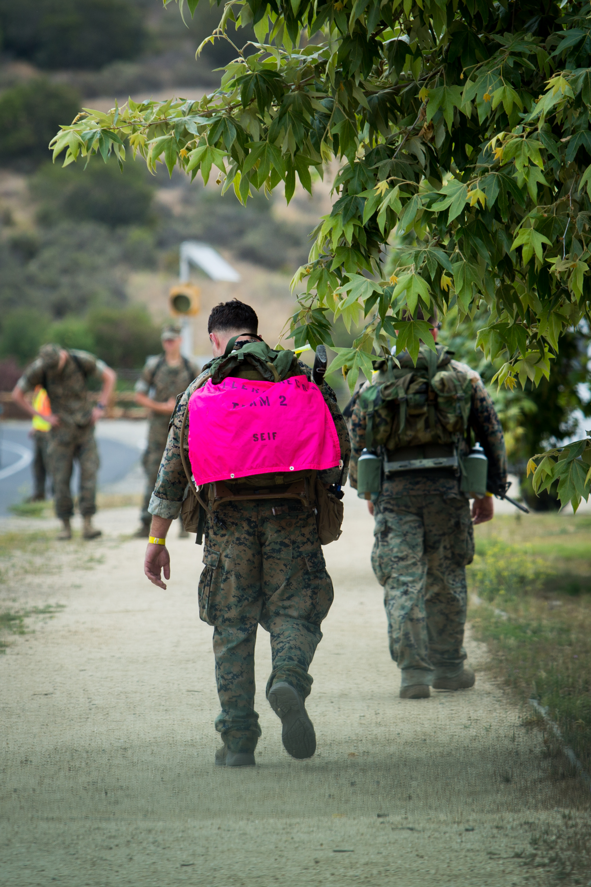 Recon Marines carry the names of their fallen brothers on their backs as they complete the Recon Challenge Thursday at Camp Pendleton.