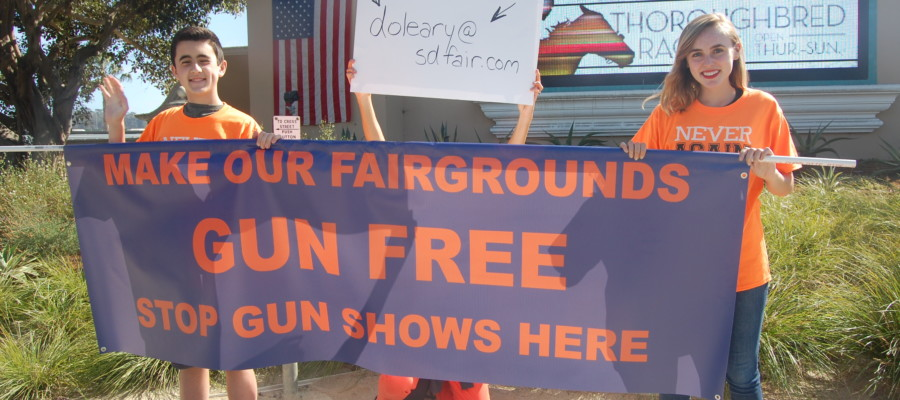 Students protest gun shows on fair's opening day