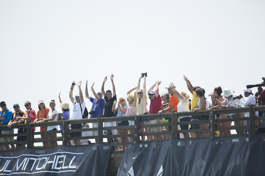 Spectators do the wave on the Oceanside Pier during the Paul Mitchell Supergirl Pro Sunday in Oceanside.