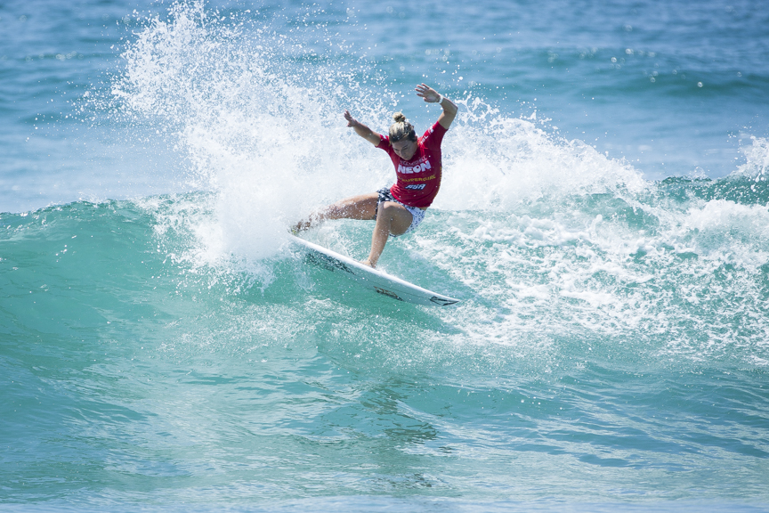 Coco Ho straps competes in the Paul Mitchell Supergirl Pro Sunday in Oceanside.