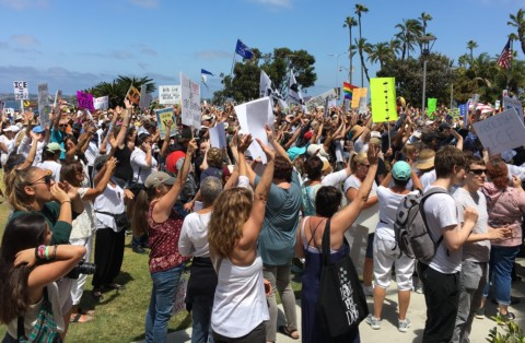 Local protestors rally in support of keeping families together at U.S. border