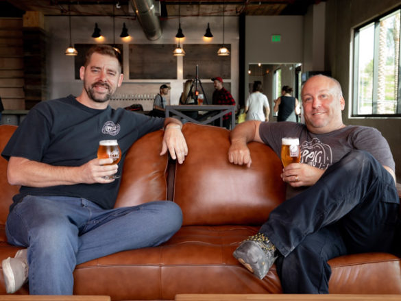 At Eppig Brewing in Vista, two of the four founders, Clayton LeBlanc and Todd Warshaw, catch their breath after the hard work of opening the new location.  Photo by Bill Vanderburgh