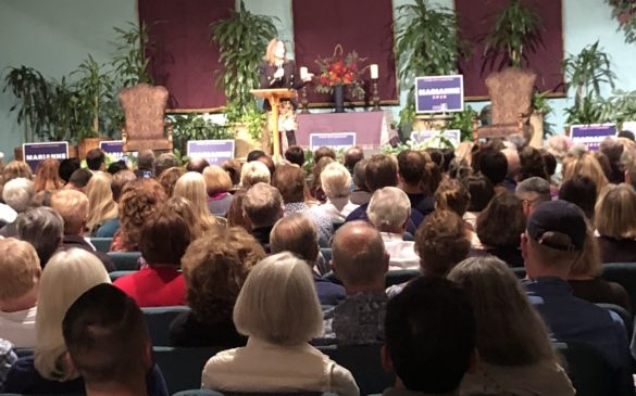 Presidential candidate Marianne Williamson speaks on stage during a town hall event at the Seaside Center for Spiritual Living campus and event center on Oct. 15.  Photo by Susan Sullivan