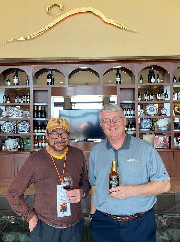 """Frank Mangio and Managing Member Ken Zignorski of Monte De Oro Winery and Vineyard enjoy a new concept from the winery, """"Forty85,"""" their 2008 dessert wine.  Photo by Rico Cassoni"""