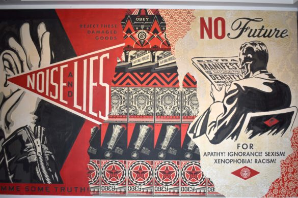 This piece by Shepard Fairey, street artist and creator of OBEY Clothing, is currently on display in the Sidewalk Activism exhibit at the Oceanside Museum of Art. Photo by Samantha Nelson.