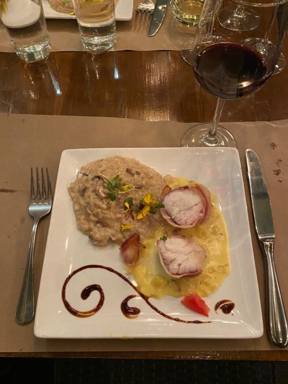 Fresh monkfish wrapped in parma ham on a bed of fennel, saffron cream sauce and porcino risotto paired with The Prisoner Red Blend. Photo by Rico Cassoni
