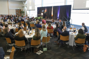 State of the City crowd at tables eating lunch