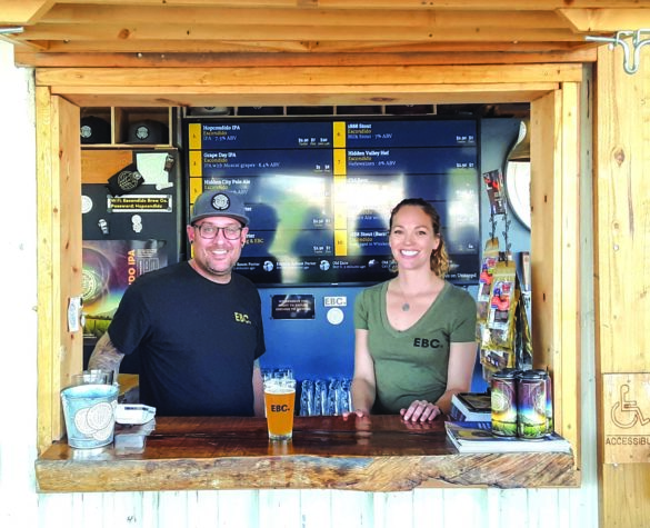 Co-owner Evan Smith and new bartender Morgan Monsanto pouring beer on a sunny Saturday at Escondido Brewing Co.  Photo by Ryan Woldt