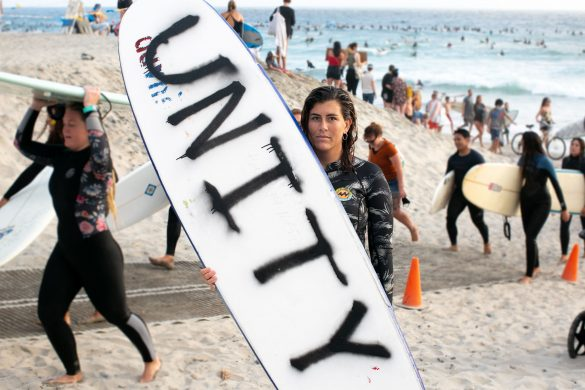 """Protesters painted surfboards and signs for the event titled, """"Unity"""" organized by local nonprofits Textured Waves, Kind Humans, and the Changing Tides Foundation."""